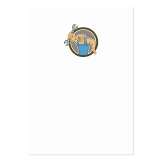 Mecánico del dogo que lleva a cabo el dibujo tarjetas de visita grandes