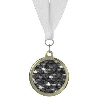 Medalla Escalas blancos y negros de Falln