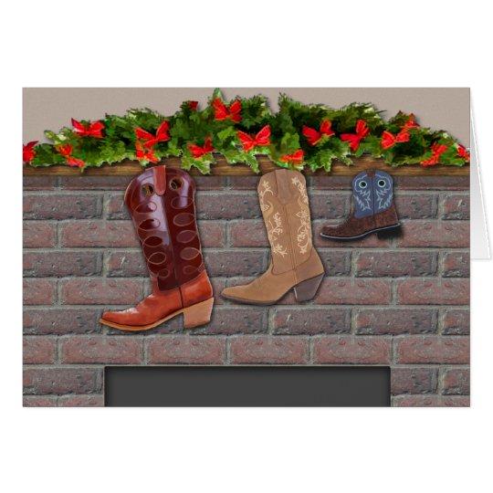 Medias de la bota de vaquero por la chimenea tarjeta de felicitación