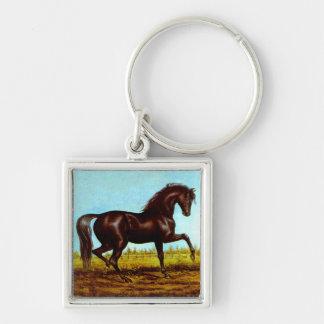 Medios galopes antiguos del caballo de la belleza llavero cuadrado plateado