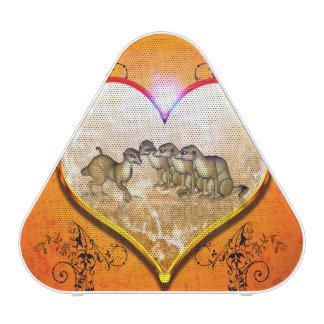 Meerkat divertido en un corazón con los elementos altavoz