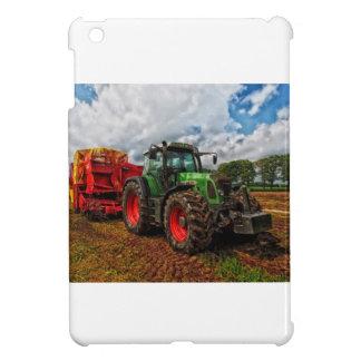 Mezclador verde del tractor y del grano
