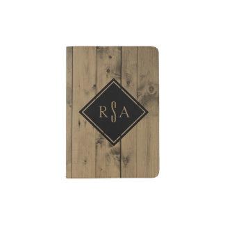 Mirada de madera del tablón del granero rústico portapasaportes