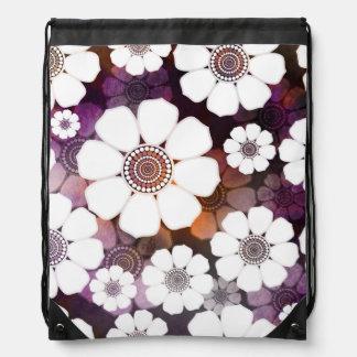 Mochila Flower power púrpura enrrollado
