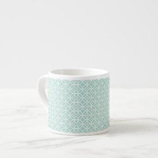 Modelo azul claro y blanco del círculo y de taza espresso