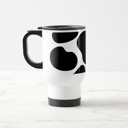 Modelo blanco y negro de la impresión de la vaca taza de café