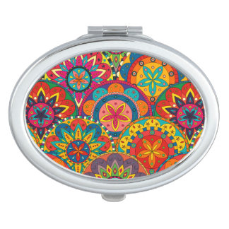 Modelo colorido retro enrrollado de la mandala espejo compacto