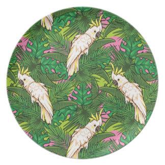 Modelo del loro con las hojas de palma plato de comida