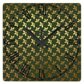 Modelo elegante del oro del acebo del navidad reloj cuadrado
