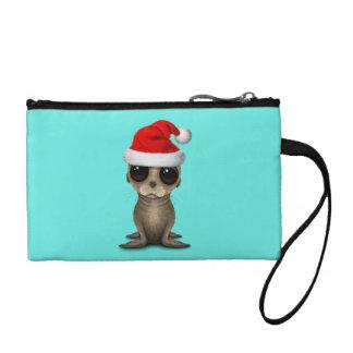 Monedero León marino del bebé que lleva un gorra de Santa