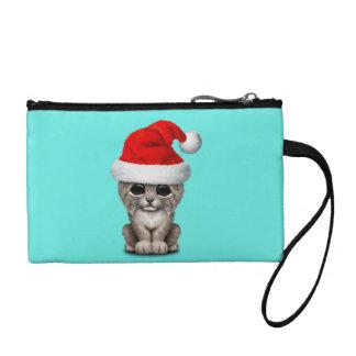 Monedero Lince lindo Cub que lleva un gorra de Santa