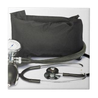 Monitor profesional negro de la presión arterial azulejo cuadrado pequeño