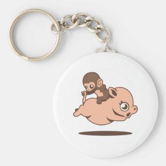 Mono del bebé (que va al revés en un cerdo) llavero redondo tipo chapa
