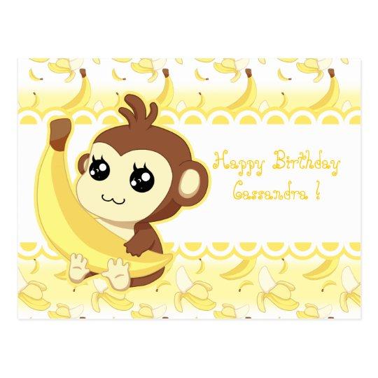 Mono lindo de Kawaii que sostiene el plátano Postal