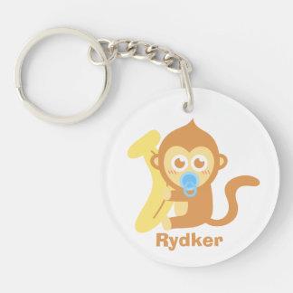 Mono lindo del bebé del dibujo animado con el plát llavero