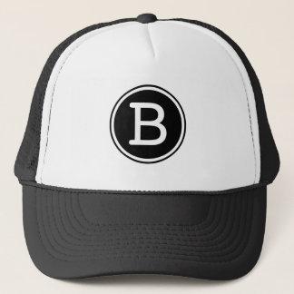 Monograma blanco del círculo del negro del anillo gorra de camionero