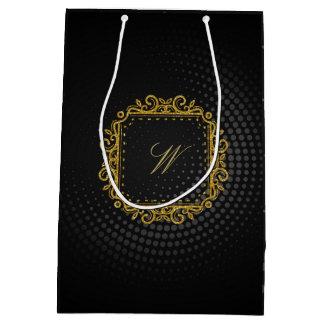 Monograma cuadrado complejo en la circular negra bolsa de regalo mediana
