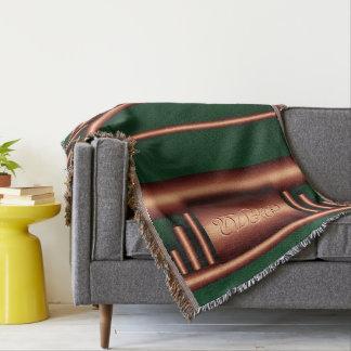 Monograma del art déco en coppper y el verde de manta