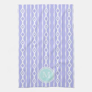 Monograma: El blanco púrpura raya la toalla