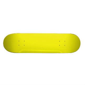Monopatín amarillo brillante sólido