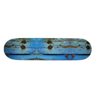 Monopatín de madera azul