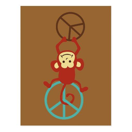 Monos del signo de la paz postal