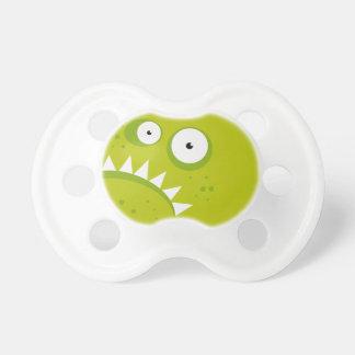 Monstruo verde asustadizo divertido enojado gruñón chupete