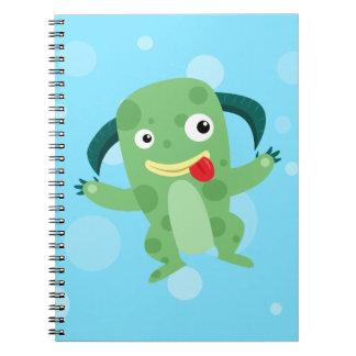 Monstruo verde tonto del dibujo animado libretas
