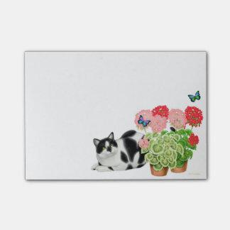 Moxie el gato de la vaca en notas de post-it de