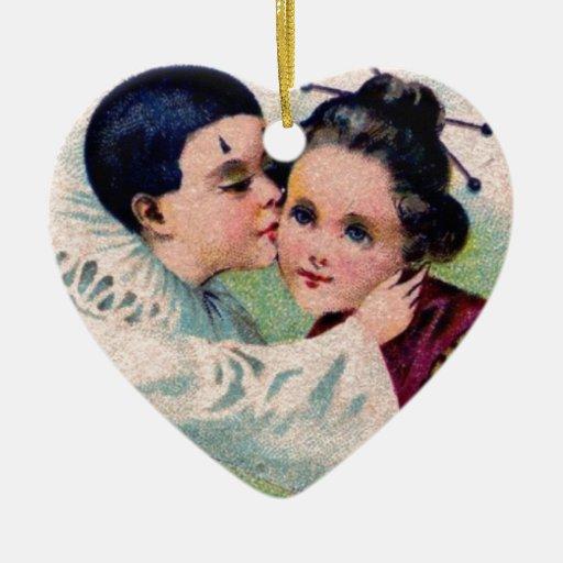 Muchacho del payaso de Pierrot que besa al chica d Adornos