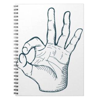 Muestra de la mano de la autorización del vintage cuaderno