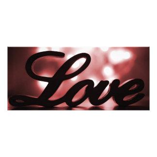 Muestra del amor con las luces rojas de la chispa tarjeta publicitaria