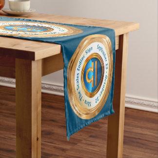 Muestra del zodiaco del libra con el texto curvado camino de mesa