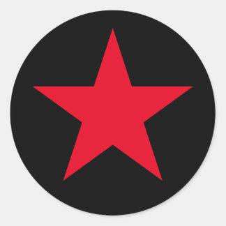 Muestra roja del símbolo de la estrella de la pegatina redonda