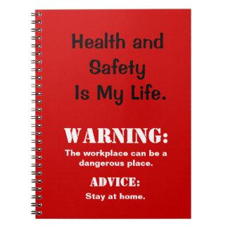 Muestra y lema divertidos del peligro de salud y d libretas espirales