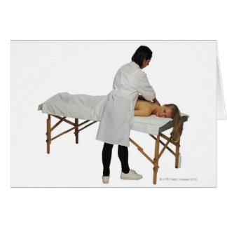 Mujer que recibe el masaje 2 felicitación