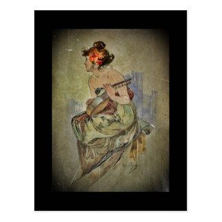 Mujer que toca el instrumento atado postal