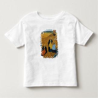Mujeres bretonas jovenes que llevan los mantones camiseta de niño