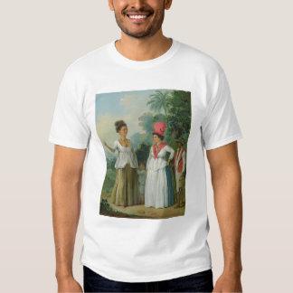 Mujeres indias del oeste del color, con un niño y camiseta