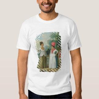 Mujeres indias del oeste del color, con un niño y camisetas