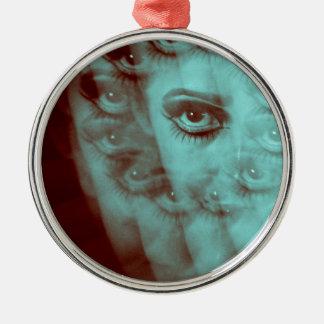 Multiple image of eye of young woman with makeup i adorno navideño redondo de metal
