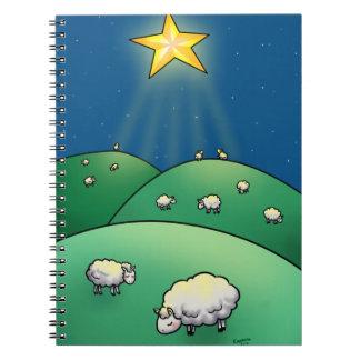 Multitud de ovejas debajo de la estrella del navid libros de apuntes