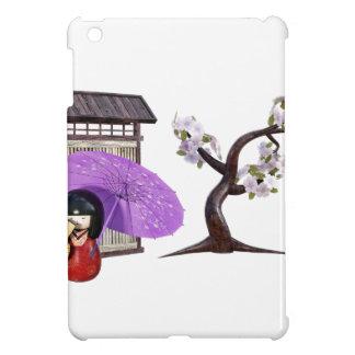 Muñeca de Sakura con la pared y el cerezo