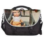 Muñeca de trapo en silla bolsas para portatil