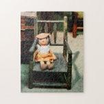 Muñeca de trapo en silla puzzle