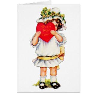 Muñeca y corazón rojo - tarjeta de la tarjeta del