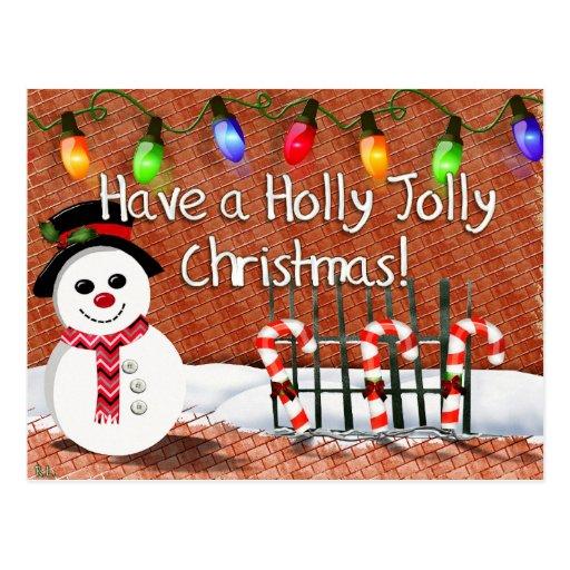 Muñeco de nieve alegre del acebo postal