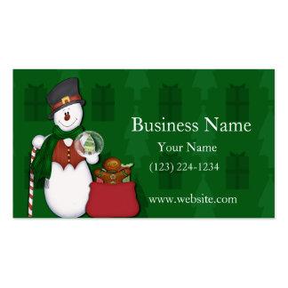 Muñeco de nieve con un bolso lleno de presentes tarjetas de visita