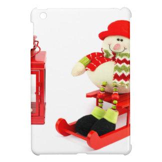 Muñeco de nieve en trineo con la linterna roja