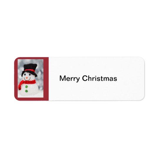 Muñeco de nieve, etiqueta de las Felices Navidad
